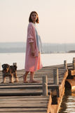 Young girl on pier Royalty Free Stock Images