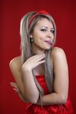 Young girl with piercing. On  red background Stock Photography