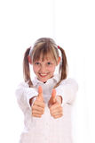 Young girl with pigtails shows two thumbs up Stock Image