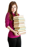 Young girl with pilе of books in hands Stock Image