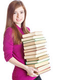 Young girl with pile of books in hands Royalty Free Stock Photos
