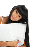 The young girl with a pillow Stock Images