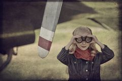 Young girl pilot. Aviator goggles vintage plane Stock Image