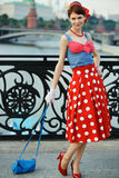 Young girl pin-up style walking at the street Stock Photos