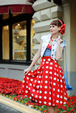 Young girl pin-up style walking at the street Royalty Free Stock Images
