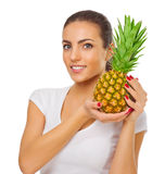 Young girl with pineapple Royalty Free Stock Photo