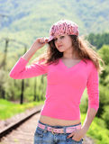 Young girl in pink. Young girl posing outside with cap on head stock photos