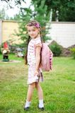 Young girl with pink backpack ready for school Stock Photos
