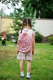 Young girl with pink backpack ready for school Stock Images
