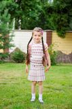 Young girl with pink backpack ready for school Royalty Free Stock Image