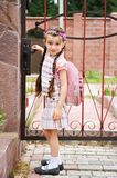 Young girl with pink bagpack leaves for school Stock Photos
