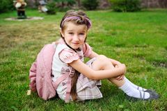 Young girl with pink bagpack ready for school Royalty Free Stock Photo