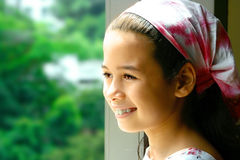 Young girl in pink bandanna Stock Images