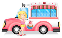 A young girl beside the pink bus Royalty Free Stock Image