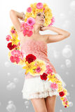Young girl in pink clothing. Young woman in pink clothing and white mini skirt with flowers Stock Photo