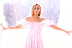 Young girl in pink dress Stock Photo