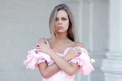 young girl in pink dress Stock Photos