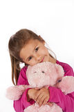 Young girl with pink dress in studio Royalty Free Stock Image