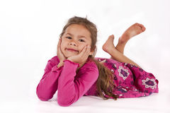 Young girl with pink dress in studio Stock Images