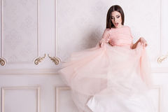 Delicate photo of a girl in a pink dress stock photos
