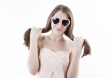 Young girl in a pink dress Stock Image