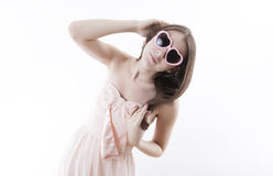 Young girl in a pink dress Stock Photography