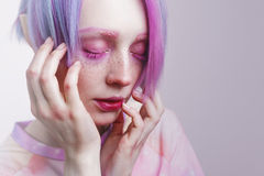 Young girl with pink eyes and hair, like a doll Royalty Free Stock Images