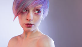 Young girl with pink eyes and hair, like a doll. A young girl with pink eyes and hair, like a doll stock photos