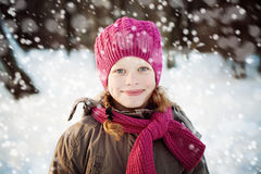 Young Girl in Pink Hat and Scarf in Park in Snowy Winter Day. Child Girl Outdoors Stock Photos