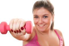 Young girl in pink holding weight for exercise Royalty Free Stock Images
