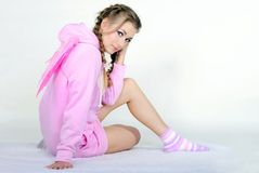 The young girl in a pink jacket with wings Stock Photography