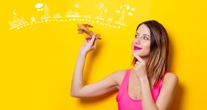 Girl holding wooden toy airplane on travel attraction Stock Photography