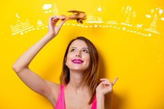 Girl holding wooden toy airplane on travel attraction Stock Photo