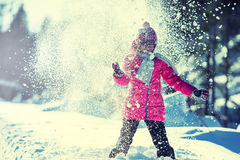 Young girl in pink playing on snow. Stock Image