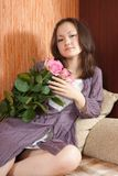 Young girl and pink roses Royalty Free Stock Images