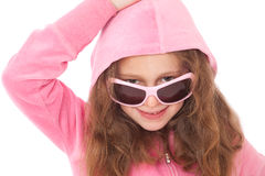 Young girl with pink sunglasses and hood Stock Photos