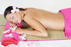 Young girl with pink towel. A young and pretty girl with pink towel in a spa Royalty Free Stock Photography
