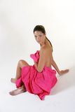 Young girl with pink towel. A young and pretty girl with pink towel in a spa Stock Image
