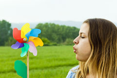 Young girl with a pinwheel Stock Photo