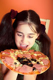 Young girl with pizza Royalty Free Stock Photography