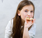 Young girl pizza. Young girl eating homemade pizza Royalty Free Stock Photography