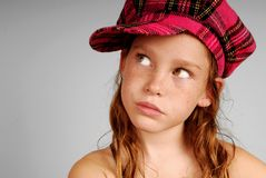 Young girl in plaid cap Stock Photography