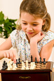 Young girl play chess cute smile Stock Photos
