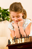 Young girl play chess cute smile Royalty Free Stock Image