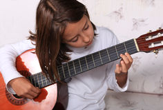 Young girl play guitar Stock Photos