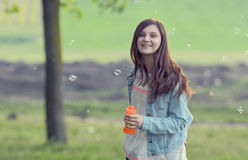 Young girl play with soap-bubbles Royalty Free Stock Photography