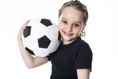 Young girl play soccer ball, Isolated over white Royalty Free Stock Photo