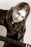 Young girl played on guitar. Photo tinted in sepia royalty free stock photo
