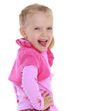 Young girl. Playful girl shows tongue on a white background.the concept of a happy childhood, education of children, teens Stock Photo