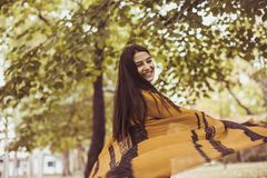 Young girl playful wit scarf at nature. On the move. Lifestyle royalty free stock photo